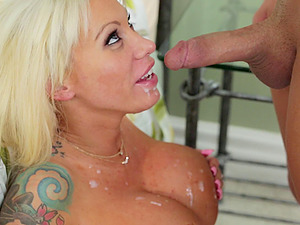 Tattooed stunner with the big round tits waits for the gooey popshot