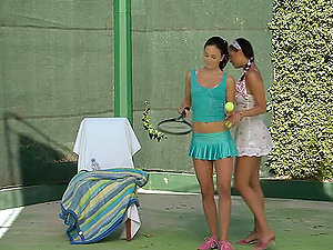 Two dark-haired lezzies frigging each other on the tennis court