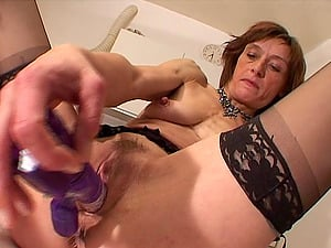 Peggie put on her sexy black stockings and commenced playing her fuck holes