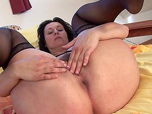 Marietta lounging in sofa in sexy underwear making herself scream