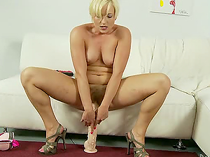 Salacious blonde Nora Skyy playing with three enormous fuck sticks