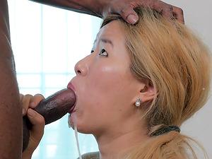 Blonde Asian bimbo gobbling a dick clean on her knees