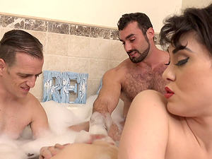 Two sexy bisexuals bathing and fucking with Audrey Noir
