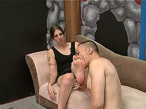 This horny stunner whoops out a little dick and frightens him