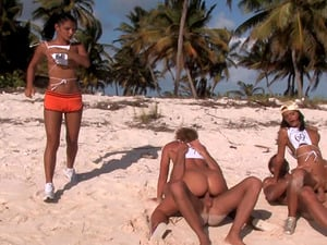Sandra Black and Lucy Belle make a cock hard during a beach orgy