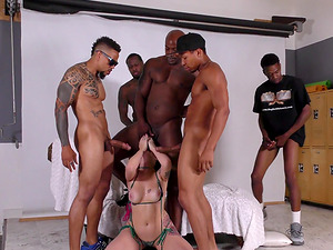 Gorgeous redhead Amber Ivy attacked by a bunch of black lovers