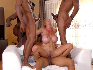 Big breasted blonde Brooke Tyler enjoys many black dicks