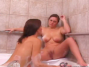 Chubby bitch and her adorable gf have fun girly-girl games in the bathroom