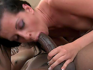 Smoking hot dark haired stunner gets banged by a black dude