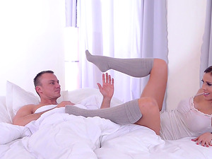 Satin Bloom uses her feet to make a man's prick hard
