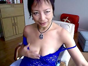 Horny Asian granny fucks herself with a dildo