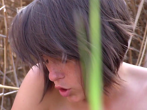 Anabelle is a honey with nice tits who loves masturbating in nature
