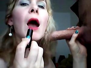 She wears red lipstick then sucks dick on webcam