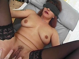 Hot milf in sexy laced stockings is blindfolded and tied in a chair.