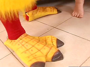 Smoking hot Lara Crow blows a stud in a chicken costume