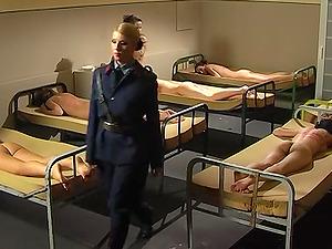 Brunette girl gets tied up before a mistress starts punishing her
