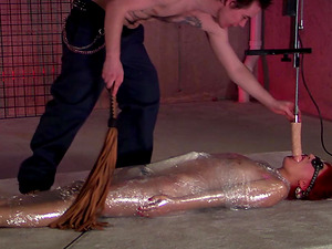 BDSM action with redhead slut sucking a dildo machine and getting pounded