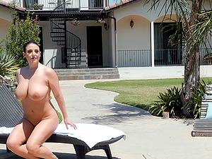 Oiled sweetie Angela White massages a dick with her wet pussy