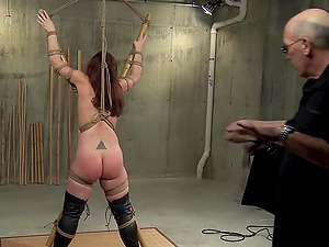 Tied up slut gets brutally spanked and fingered by her master