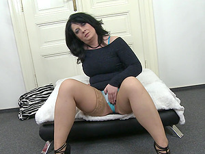 Dark haired amateur mature MILF Milana fingers her shaved pussy