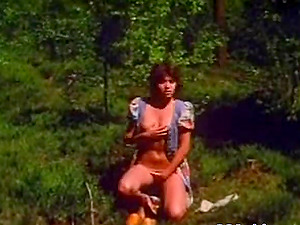 Girl undresses and then works her hairy pussy out in nature