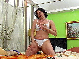 Busty brunette MILF Giovana S. masturbates while on her phone