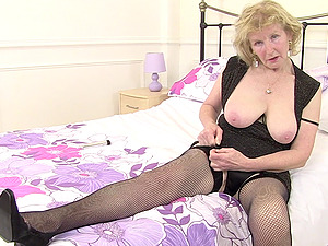Mature amateur blonde British granny shows off her pierced pussy