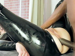 Horny brunette babe in latex catsuit take big black cock up her butt