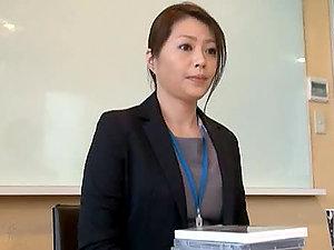 Japanese Mature Woman masturbates in the office