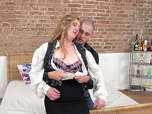 Blonde mature MILF in high heels Angelica blows cock