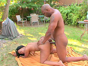 Buxom mature ebony babe Miyamme Spice rides a black dick outdoors