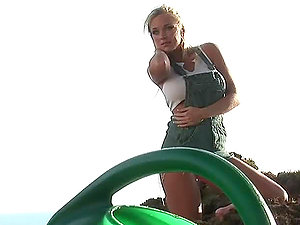 Sexy blonde Shawn Hektor wipes herself with mud outdoors