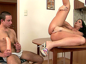 Dude jams a fat faux-cock in Simony's cock-squeezing twat