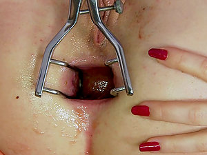 Two tarts are tugging and pumping each other with faux-cocks