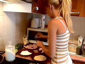 Pretty blonde Sophie Moone cooks breakfast in the kitchen