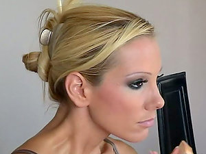 Behind the scenes with pornography starlet getting her make up done