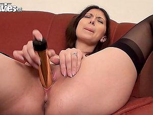 Black-haired Beauty Sarah Dark in Stockings Masturbates wtih Shiny Fuck stick