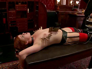 Ball-gagged and tied up ginger-haired chick get toyed and clothespinned