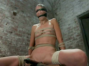 Pretty Amber Rayne gets tied up to a tabouret and toyed