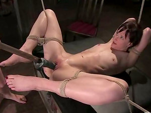 Bonded dark haired gets whipped and toyed by blonde