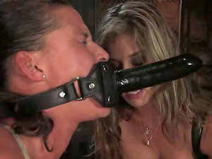 Brown-haired woman gets whipped and toyed by Felony