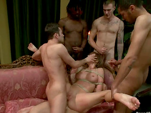 Tied up and ball-gagged Amy Brooke gets fucked rough by four dudes