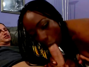 This adorable black whore is sucking some milky jizz-shotgun for this interracial romp vid