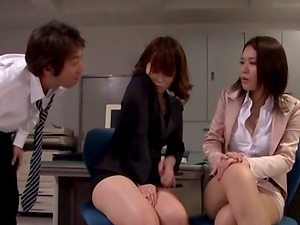 Two stunning Japanese office chicks give a handjob in an office