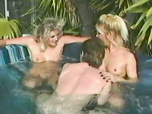 Two blondes have a threesome hook-up in an inflatable pool