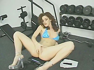 Gorgeous Kayla frigs and fucktoys herself in a gym