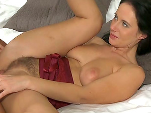Chesty brown-haired deep throats a dick and gets her hairy vulva smashed