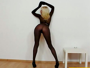 Smoking hot ash-blonde siren puts on her nylon suit and fucks herself
