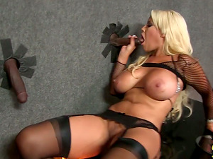 A yummy blondie stripper is going to suck two black shafts