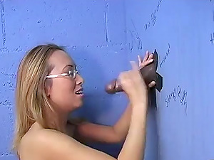Asian Nymph Gets Some Black Hard-on at a Pornography Store Gloryhole